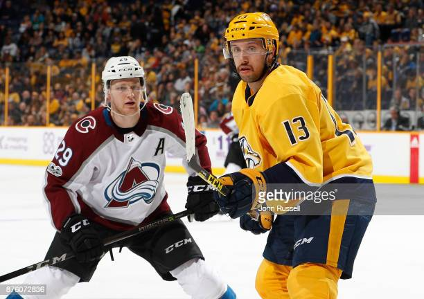 Nick Bonino of the Nashville Predators skates against Nathan MacKinnon of the Colorado Avalanche during an NHL game at Bridgestone Arena on November...
