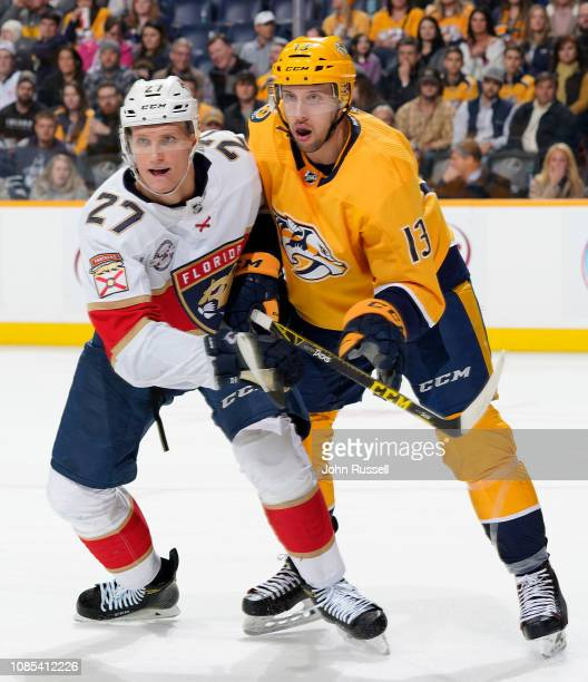 Nick Bonino of the Nashville Predators skates against Nick Bjugstad of the Florida Panthers at Bridgestone Arena on January 19 2019 in Nashville...