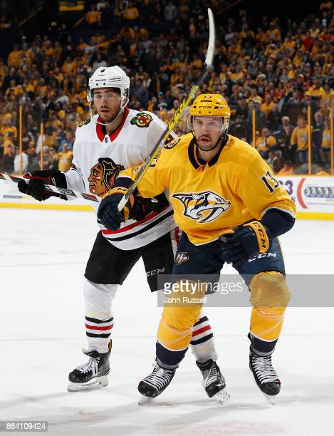 Nick Bonino of the Nashville Predators skates against Nick Schmaltz of the Chicago Blackhawks during an NHL game at Bridgestone Arena on November 28...