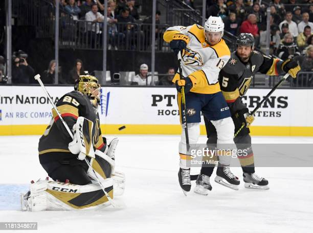 Nick Bonino of the Nashville Predators tips a shot by teammate Kyle Turris past Marc-Andre Fleury of the Vegas Golden Knights for a power-play goal...