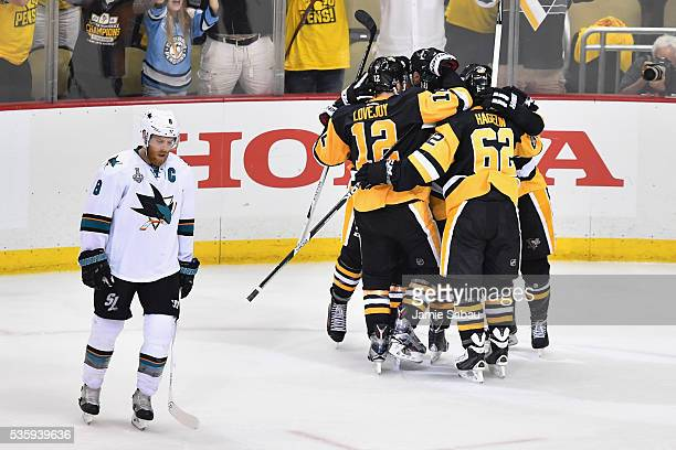 Nick Bonino of the Pittsburgh Penguins celebrates with teammates after scoring a third period goal against the San Jose Sharks as Joe Pavelski reacts...