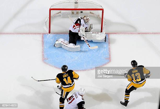 Nick Bonino of the Pittsburgh Penguins scores past Mike Smith of the Arizona Coyotes at PPG Paints Arena on December 12 2016 in Pittsburgh...