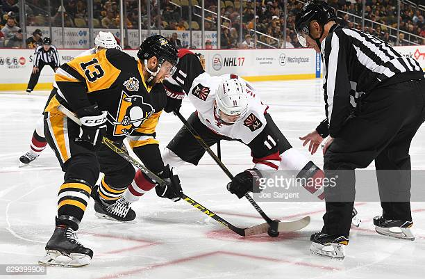 Nick Bonino of the Pittsburgh Penguins takes a faceoff against Martin Hanzal of the Arizona Coyotes at PPG Paints Arena on December 12 2016 in...