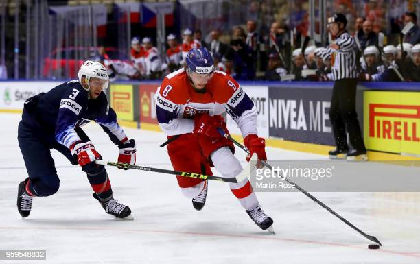 Nick Bonino of the United States and Libor Sulak of Czech Republic battle for the puck during the 2018 IIHF Ice Hockey World Championship Quarter...