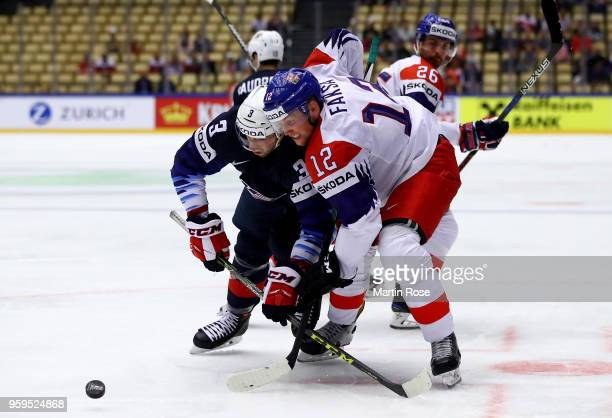 Nick Bonino of the United States and Radek Faksa of Czech Republic battle for the puck during the 2018 IIHF Ice Hockey World Championship Quarter...