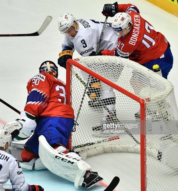 Nick Bonino of the United States fights for the puck with Norway's Alexander Bonsaksen during the group B match Norway vs the US of the 2018 IIHF Ice...