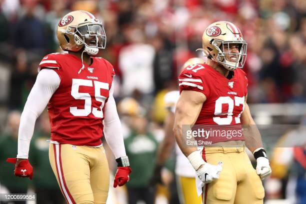 Nick Bosa and Dee Ford of the San Francisco 49ers reacts after a play against the Green Bay Packers during the NFC Championship game at Levi's...
