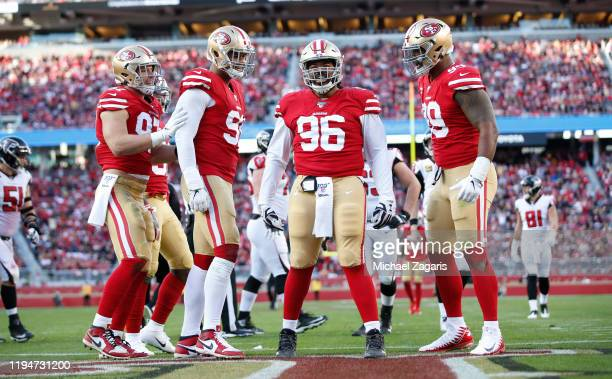 Nick Bosa Arik Armstead Sheldon Day and DeForest Buckner of the San Francisco 49ers celebrate a sack during the game against the Atlanta Falcons at...