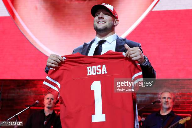 Nick Bosa of Ohio State reacts after being chosen overall by the San Francisco 49ers during the first round of the 2019 NFL Draft on April 25 2019 in...