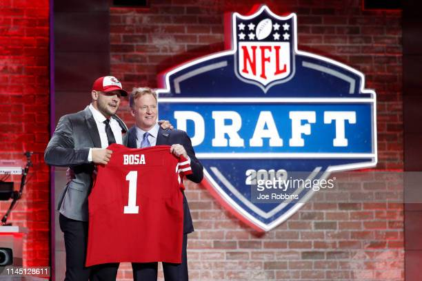 Nick Bosa of Ohio State with NFL commissioner Roger Goodell after being announced as the second pick in the first round of the NFL Draft by the San...