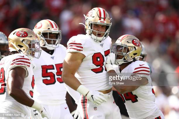 Nick Bosa of the San Francisco 49ers celebrates after sacking Kyle Allen of the Carolina Panthers during the first quarter at Levi's Stadium on...