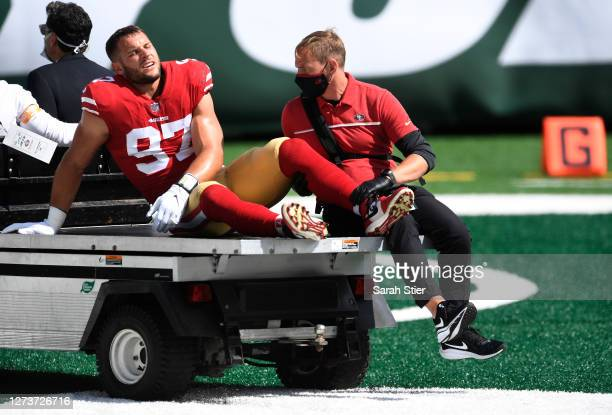 Nick Bosa of the San Francisco 49ers is carted off the field after sustaining an injury during the first half against the New York Jets at MetLife...