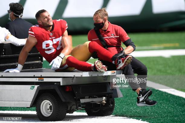 Nick Bosa of the San Francisco 49ers is driven off the field after an injury during the first half of the game against the New York Jets at MetLife...