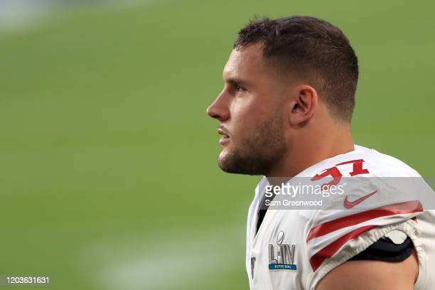 Nick Bosa of the San Francisco 49ers looks on prior to Super Bowl LIV against the Kansas City Chiefs at Hard Rock Stadium on February 02, 2020 in...