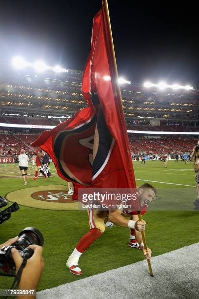 Nick Bosa of the San Francisco 49ers plants a 49ers flag in the field after a win against the Cleveland Browns at Levi's Stadium on October 07, 2019...