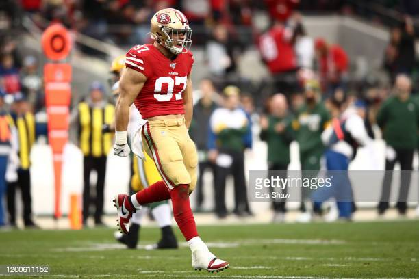 Nick Bosa of the San Francisco 49ers reacts to sacking Aaron Rodgers of the Green Bay Packers in the first quarter during the NFC Championship game...