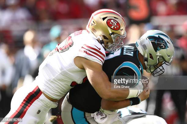 Nick Bosa of the San Francisco 49ers sacks Kyle Allen of the Carolina Panthers during the first quarter at Levi's Stadium on October 27 2019 in Santa...