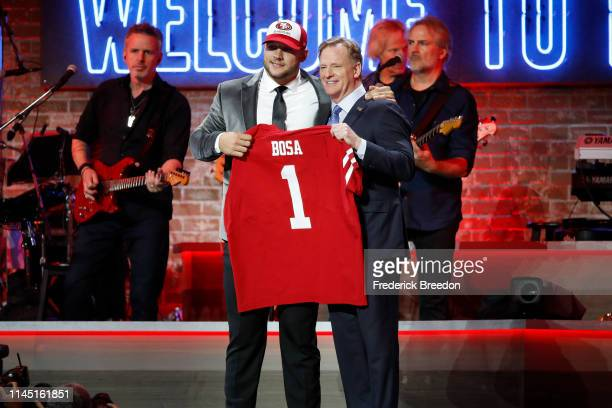 Nick Bosa poses with NFL commissioner Roger Goodell after being picked 2nd overall by the San Francisco 49ers on day 1 of the 2019 NFL Draft on April...