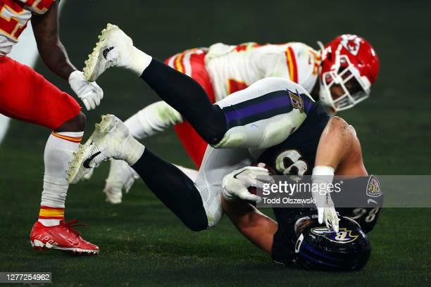 Nick Boyle of the Baltimore Ravens catch a touchdown in the fourth quarter against Rashad Fenton and Juan Thornhill of the Kansas City Chiefs at M&T...