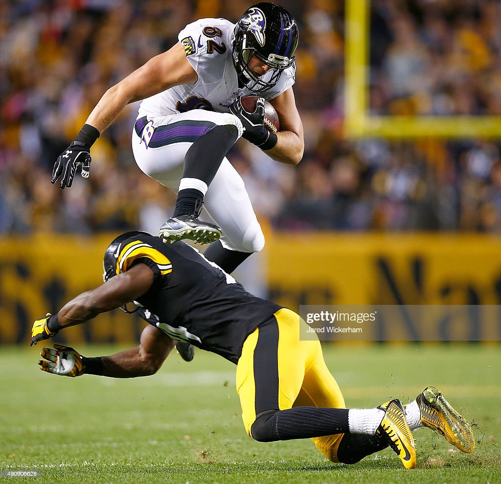 Nick Boyle #82 of the Baltimore Ravens leaps over a Pittsburgh Steeler defender during the game at Heinz Field on October 1, 2015 in Pittsburgh, Pennsylvania.