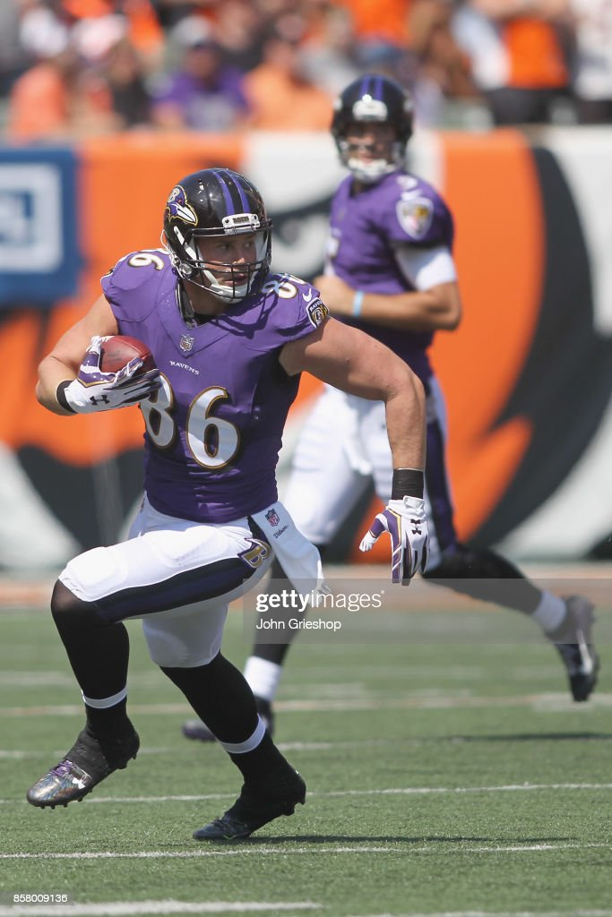 Nick Boyle #86 of the Baltimore Ravens runs the football upfield during the game against the Cincinnati Bengals at Paul Brown Stadium on September 10, 2017 in Cincinnati, Ohio.The Ravens defeated the Bengals 20-0.