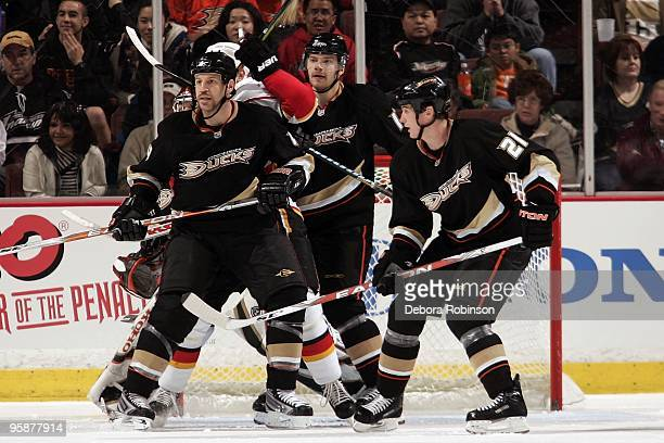 Nick Boynton Evgeny Artyukhin and Sheldon Brookbank of the Anaheim Ducks defends in the crease against the Calgary Flames during the game on January...