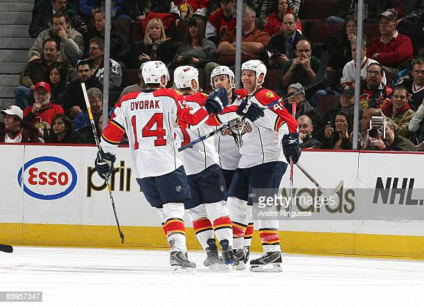 Nick Boynton of the Florida Panthers celebrates his first period goal against the Ottawa Senators with Radek Dvorak of the Florida Panthers and...