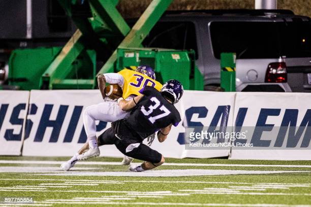 Nick Brish of the University of Mount Union tackles Carl Robinson III of the University of Mary HardinBaylor for a safety during the Division III...