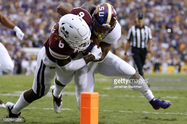Nick Brossette of the LSU Tigers is tackled by Willie Gay Jr #6 of the Mississippi State Bulldogs during the first half at Tiger Stadium on October...