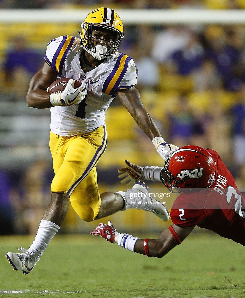 Nick Brossette #4 of the LSU Tigers runs with the ball as Daniel Byrd #2 of the Jacksonville State Gamecocks defends during the second half of a game at Tiger Stadium on September 10, 2016 in Baton Rouge, Louisiana.