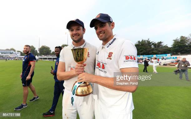 Nick Browne and Alastair Cook of Essex lift the County Championship trophy during day three of the Specsavers County Championship Division One match...
