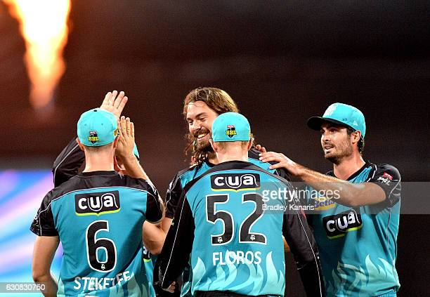Nick Buchanan of the Heat celebrates taking the wicket of Henriques Moises of the Sixers during the Big Bash League match between the Brisbane Heat...