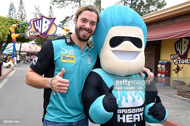 Nick Buchanan of the Heat poses with 'Heater' during the Women's Big Bash League media opportunity on October 19 2015 on the Gold Coast Australia
