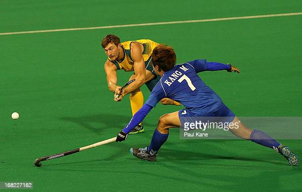 Nick Budgeon of Australia passes the ball against Kang Moon Kweon of Korea during the International Test match between the Australian Kookaburras and...