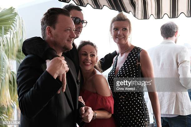 Nick Bull John Niven and Eva McBride attend the launch of Jade Jagger's new fine jewelry collection at Chateau Marmont on April 14 2016 in Los...
