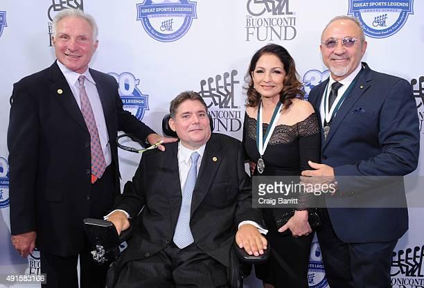 Nick Buoniconti Marc Buoniconti Gloria Estefan and Emilio Estefan attend the 30th Annual Great Sports Legends Dinner to benefit The Buoniconti Fund...