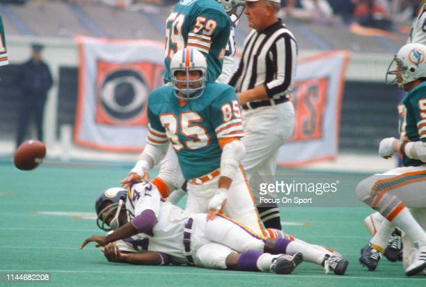 Nick Buoniconti of the Miami Dolphins tackles John Gilliam of the Minnesota Vikings during Super Bowl VIII at Rice Stadium January 13 1974 in Houston...