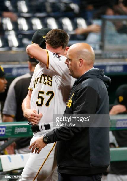 Nick Burdi of the Pittsburgh Pirates walks off the field injured in the eighth inning against the Arizona Diamondbacks at PNC Park on April 22 2019...