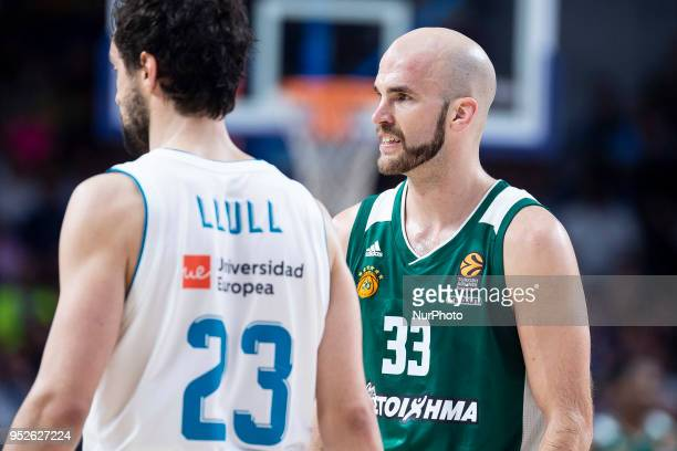 Nick Calathes #33 of Panathinaikos Superfoods Athens and Sergio Llull of Real Madrid during the Turkish Airlines Euroleague Play Offs Game 4 between...