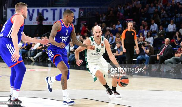 Nick Calathes #33 of Panathinaikos Superfoods Athens competes with Ricky Ledo #1 of Anadolu Efes Istanbul during the 2017/2018 Turkish Airlines...