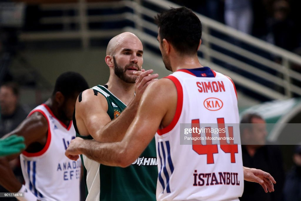 Nick Calathes, #33 of Panathinaikos Superfoods Athens exchange handshake with Krunoslav Simon, #44 of Anadolu Efes Istanbul during the 2017/2018 Turkish Airlines EuroLeague Regular Season Round 16 game between Panathinaikos Superfoods Athens and Anadolu Efes Istanbul at Olympic Sports Center Athens on January 4, 2018 in Athens, Greece.