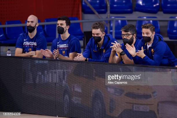 Nick Calathes, #99 of FC Barcelona, Leo Westermann, #2 of FC Barcelona and Pau Gasol follow the game during the Liga Endesa match between FC...