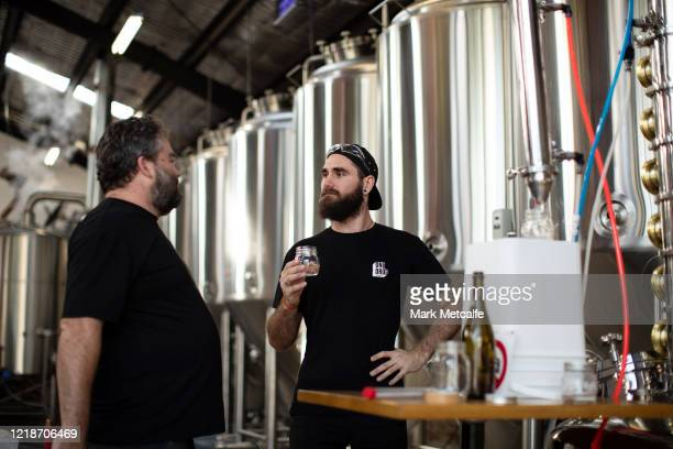 Nick CalderScholes head brewer at One Drop Brewing makes quality checks during still operation on April 13 2020 in Sydney Australia Brewers and...