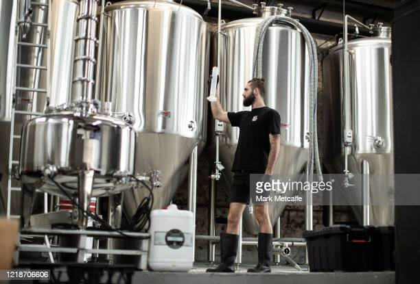 Nick CalderScholes head brewer at One Drop Brewing makes quality checks during the sugar wash production on April 1 2020 in Sydney Australia Brewers...