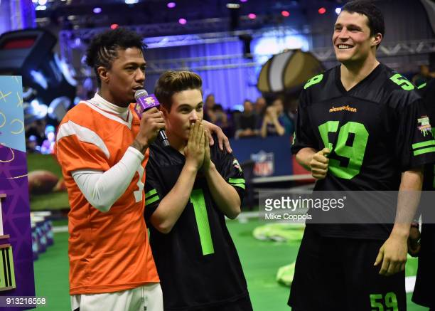 Nick Cannon actor Ricardo Hurtado and NFL player Luke Kuechly attend the Superstar Slime Showdown taping at Nickelodeon at the Super Bowl Experience...