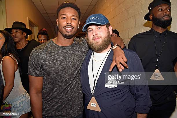 Nick Cannon and actor Jonah Hill pose backstage during Kanye West The Saint Pablo Tour at Madison Square Garden on September 5 2016 in New York City