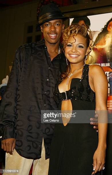 Nick Cannon and Christina Milian during Love Don't Cost a Thing Los Angeles Premiere Red Carpet at Mann's Chinese Theatre in Hollywood California...