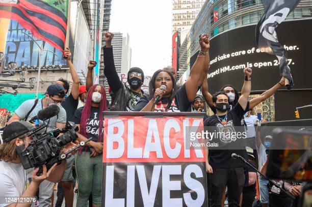 Nick Cannon and Cofounder BLM Greater NY Chivona Newsome speak at a Black Lives Matter rally in Times Square on June 07 2020 in New York New York