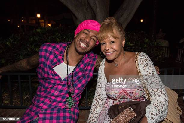 Nick Cannon and his mother Beth Hackett visit Disneyland on April 30 2017 in Anaheim California