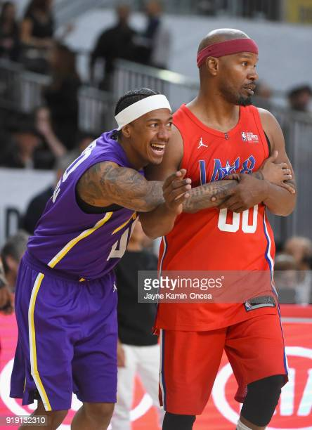 Nick Cannon and Jamie Foxx vie for position during the 2018 NBA AllStar Game Celebrity Game at Los Angeles Convention Center on February 16 2018 in...